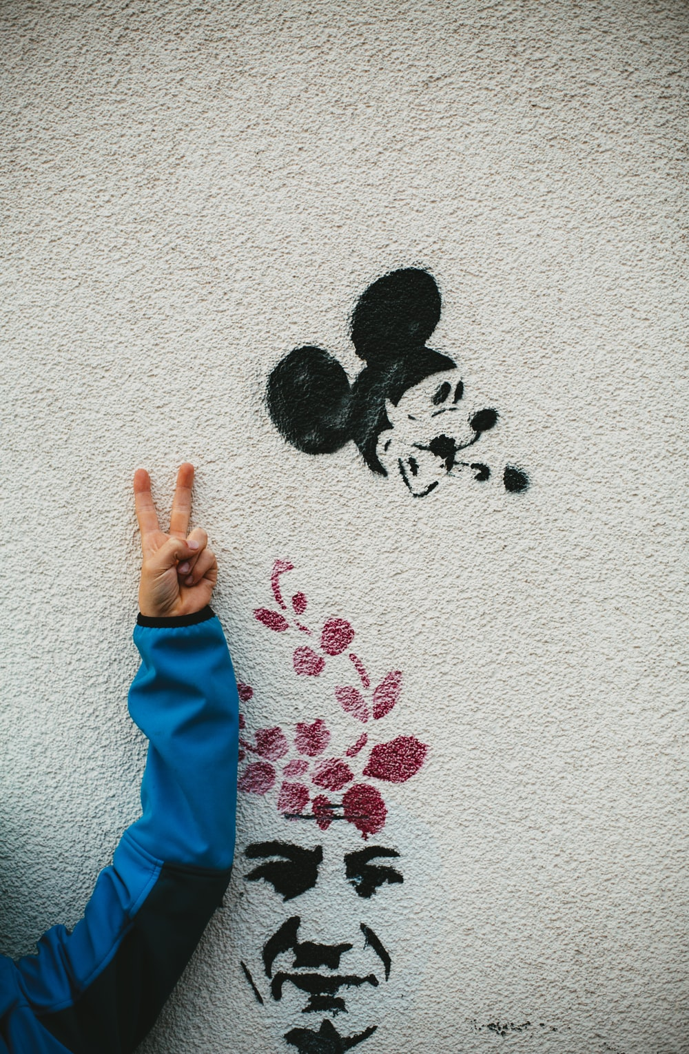Mickey Mouse and man's face painted on the wall