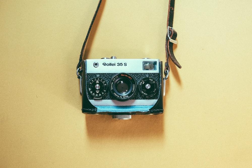 gray and black Polaroid camera