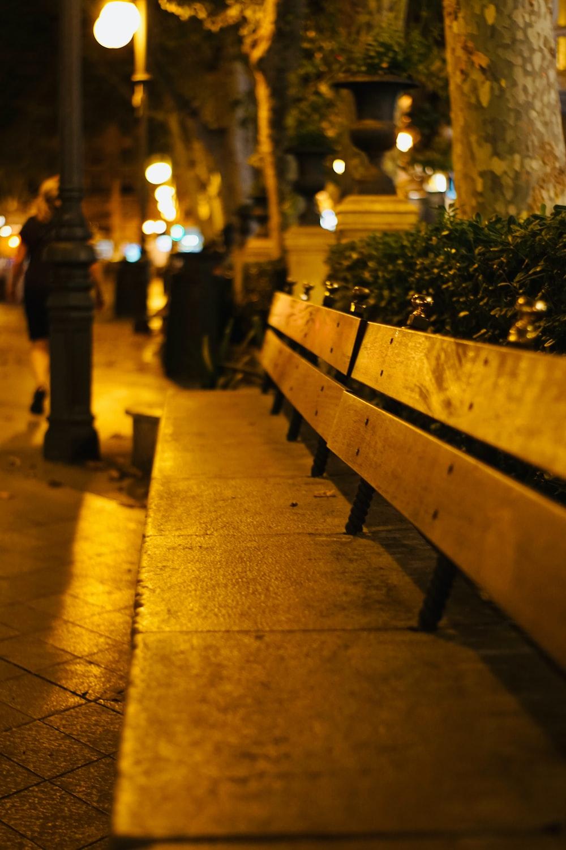 empty bench near lamp post