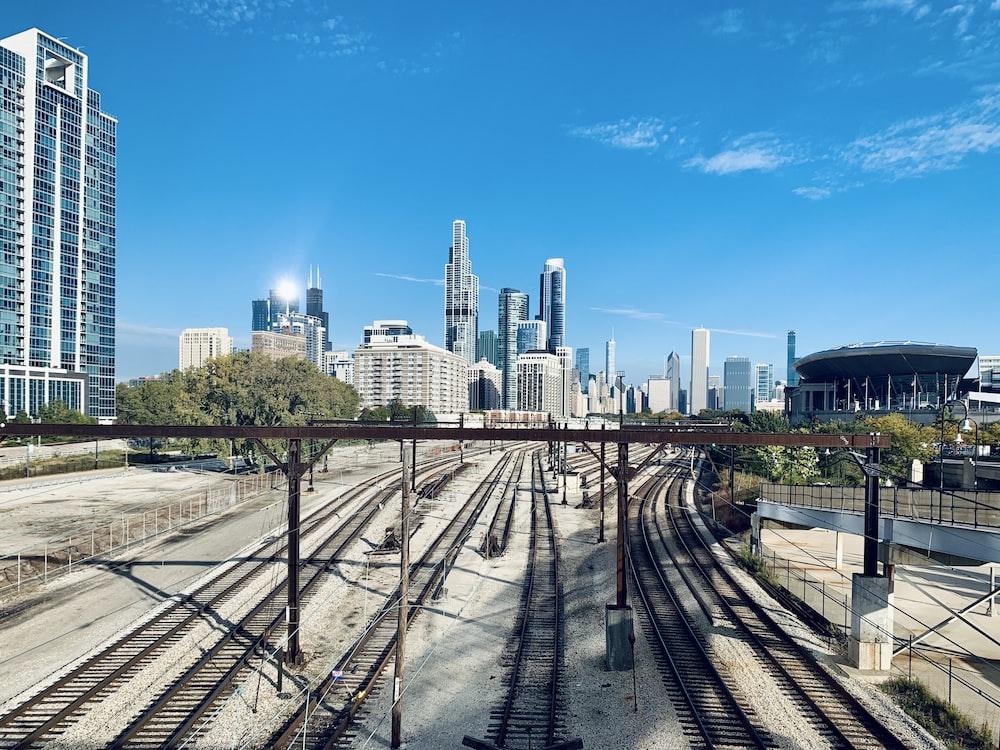 railways near high-rise buildings at daytime