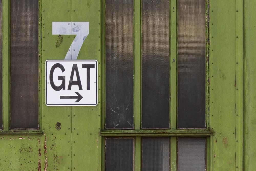 GAT signage on green glass door