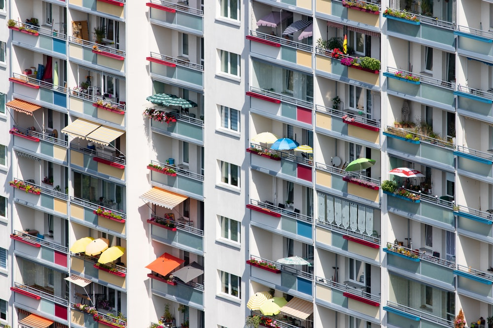 people in white and multicolored high-rise building