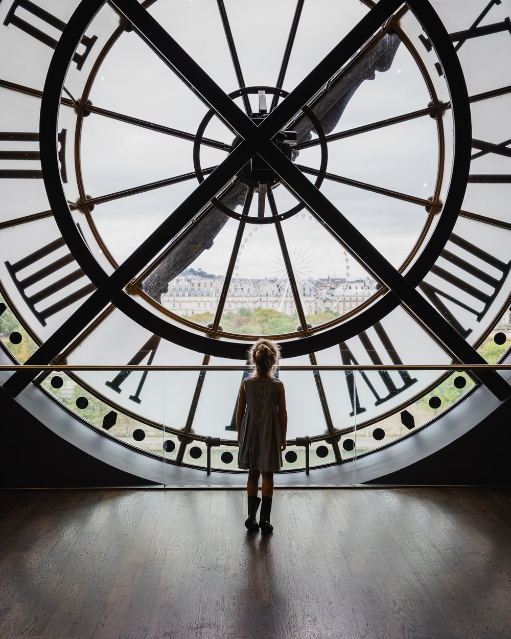 girl standing inside of tower clock