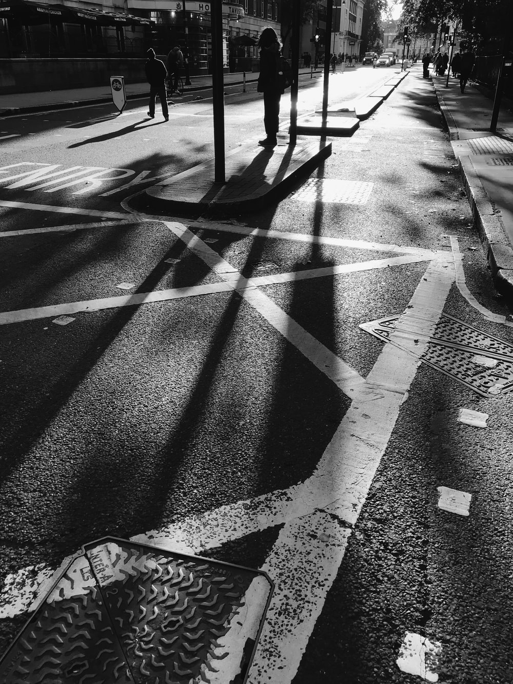 grayscale photography of road during daytime
