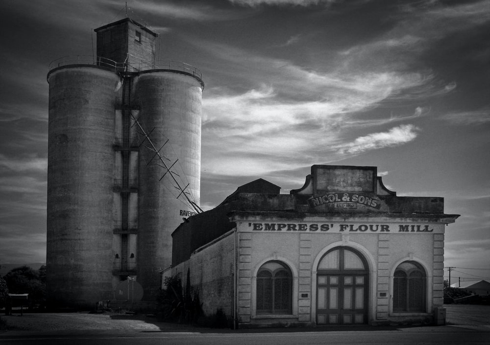 grayscale photography of Empress Flour Mill