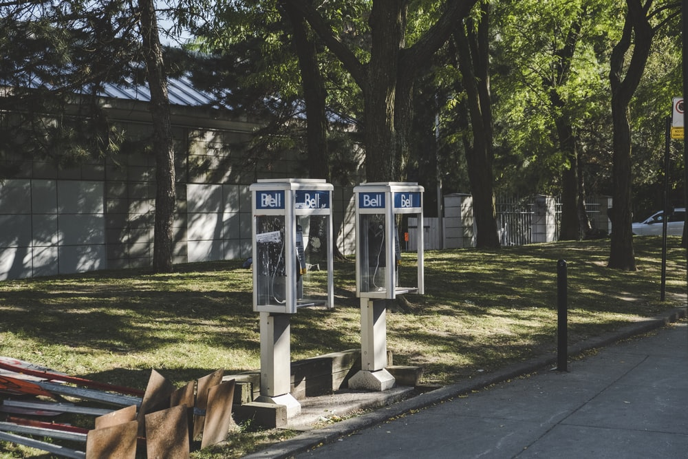 shallow focus photo of white telephone booth