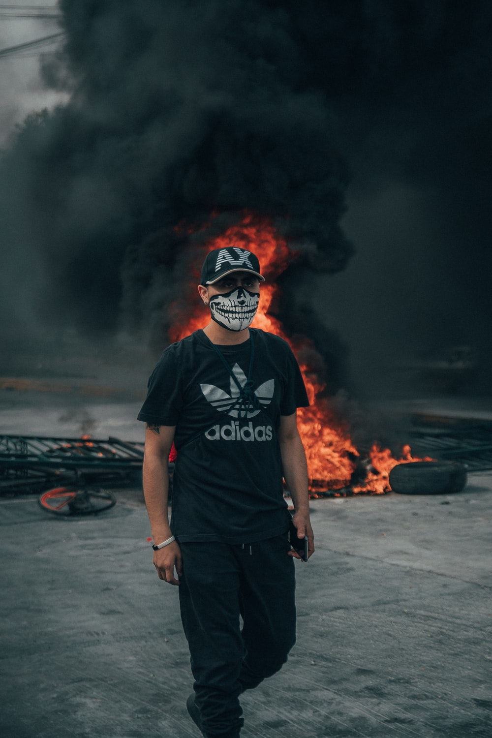 man in skull mask and black Adidas t-shirt