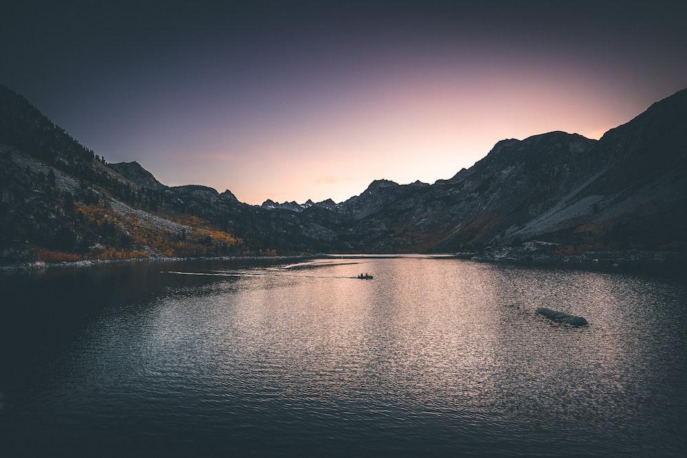 lake surround by mountain during nighttime