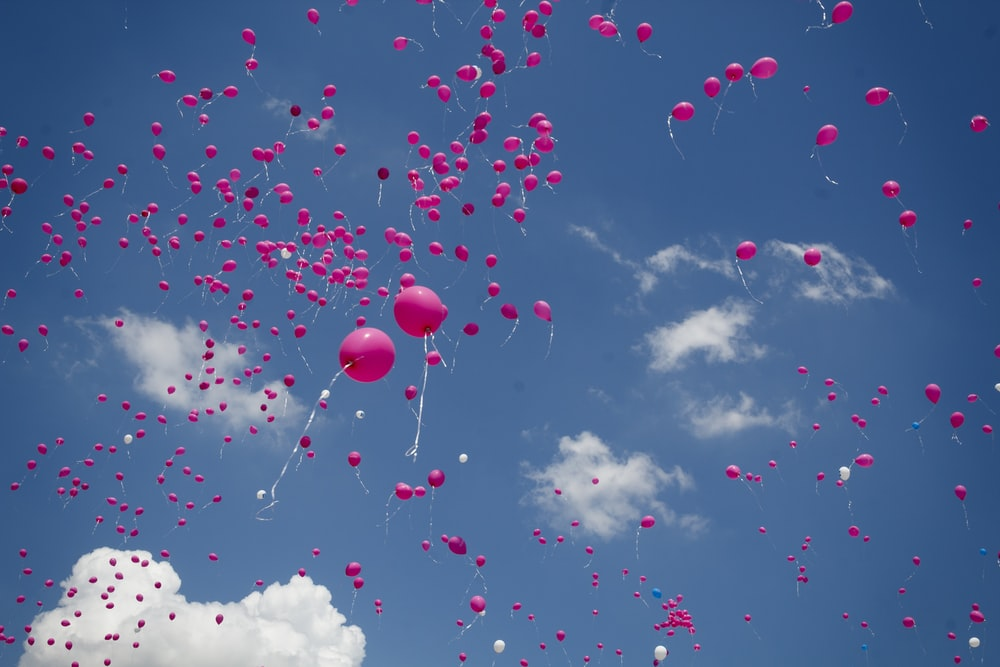 pink balloon lot on air during daytime