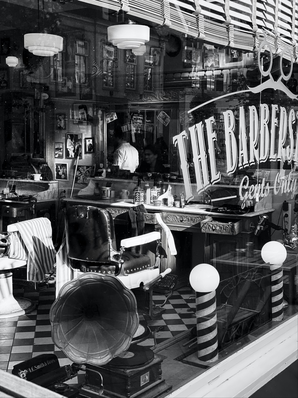 The Barbers store in grayscale photography