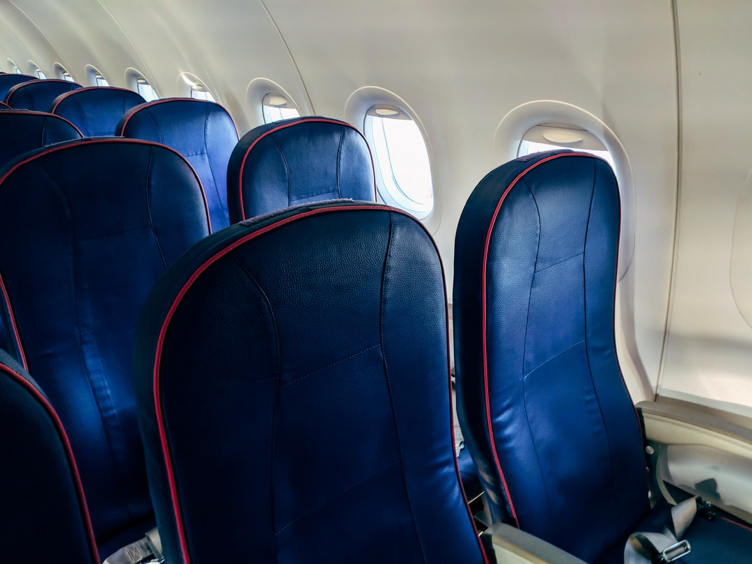 Blue airline seats in an Airbus