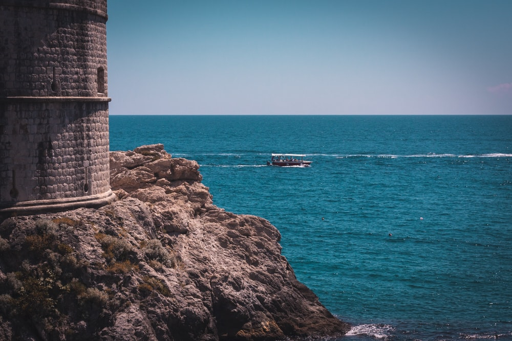 gray lighthouse and blue sea