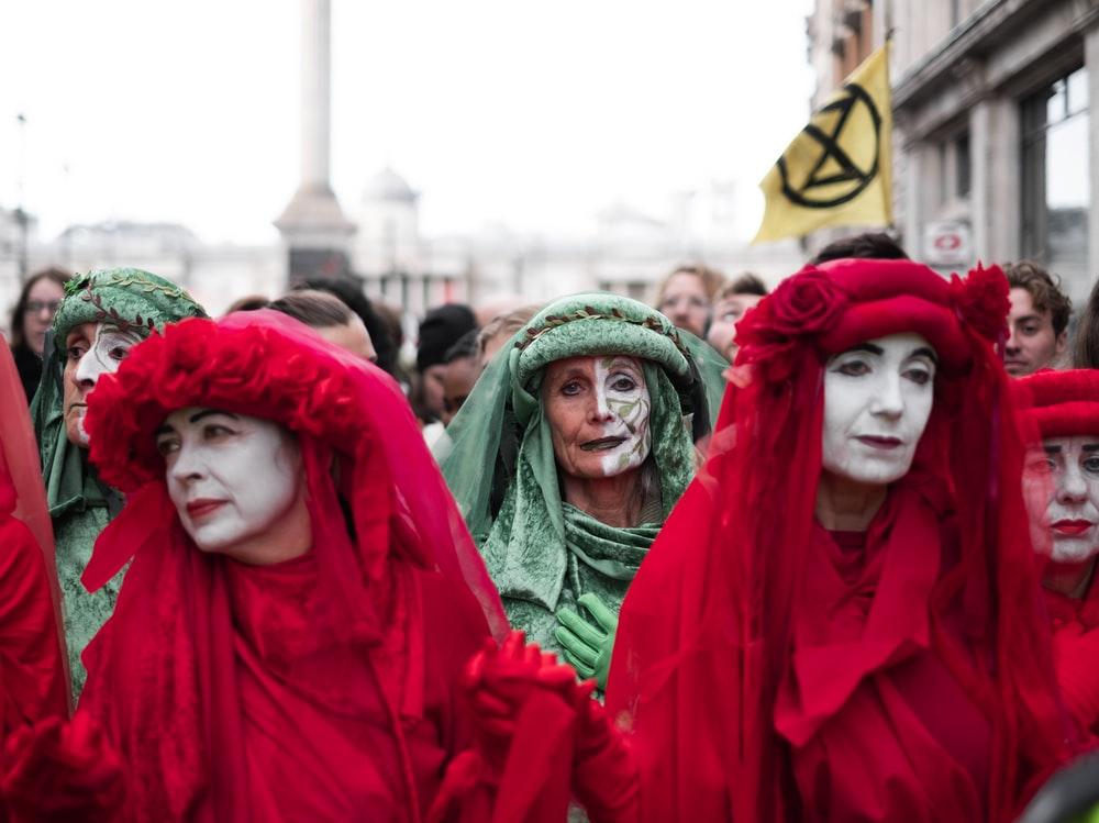 people wearing red and green veils