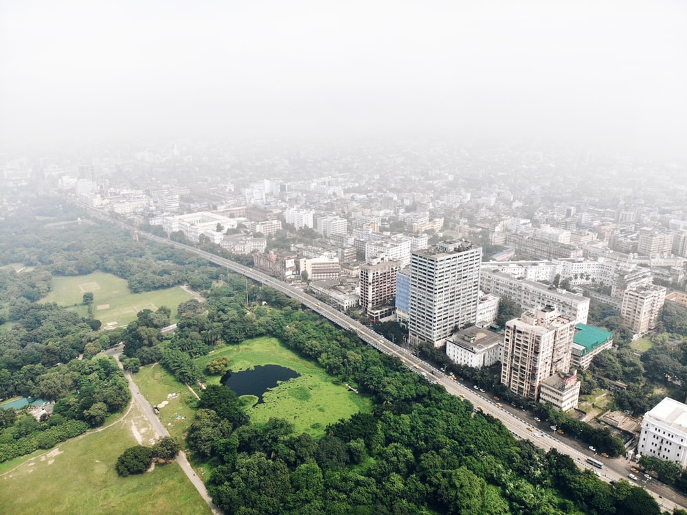 aerial photography of city with high-rise buildings and park during daytime