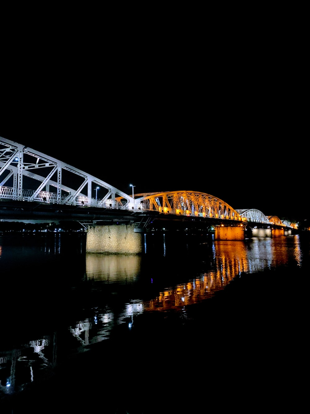 white and orange steel bridge during night time
