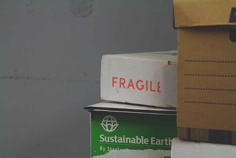 white and red Fragile labeled box