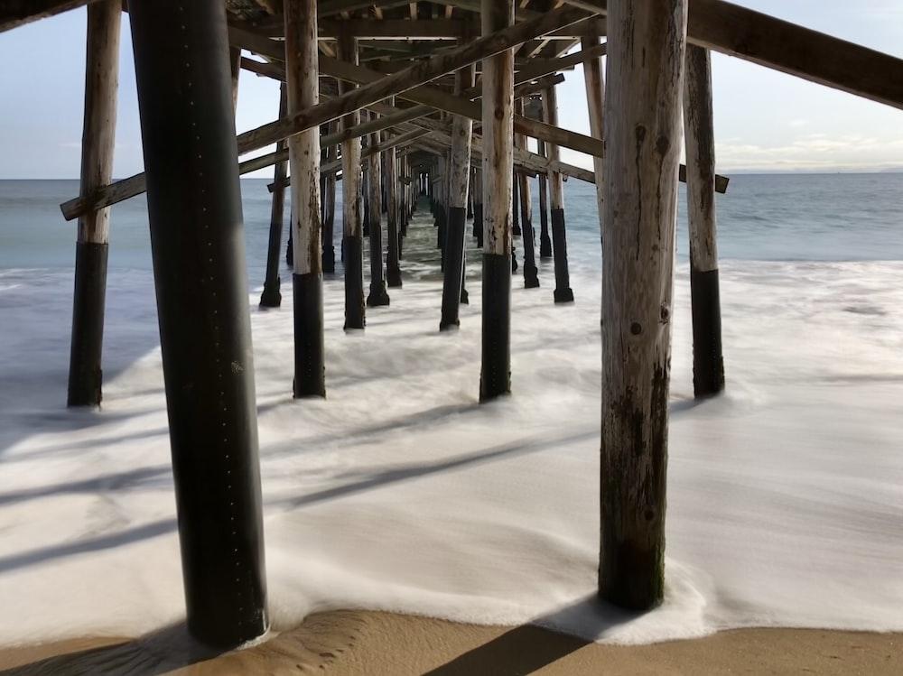 white wooden sea dock post