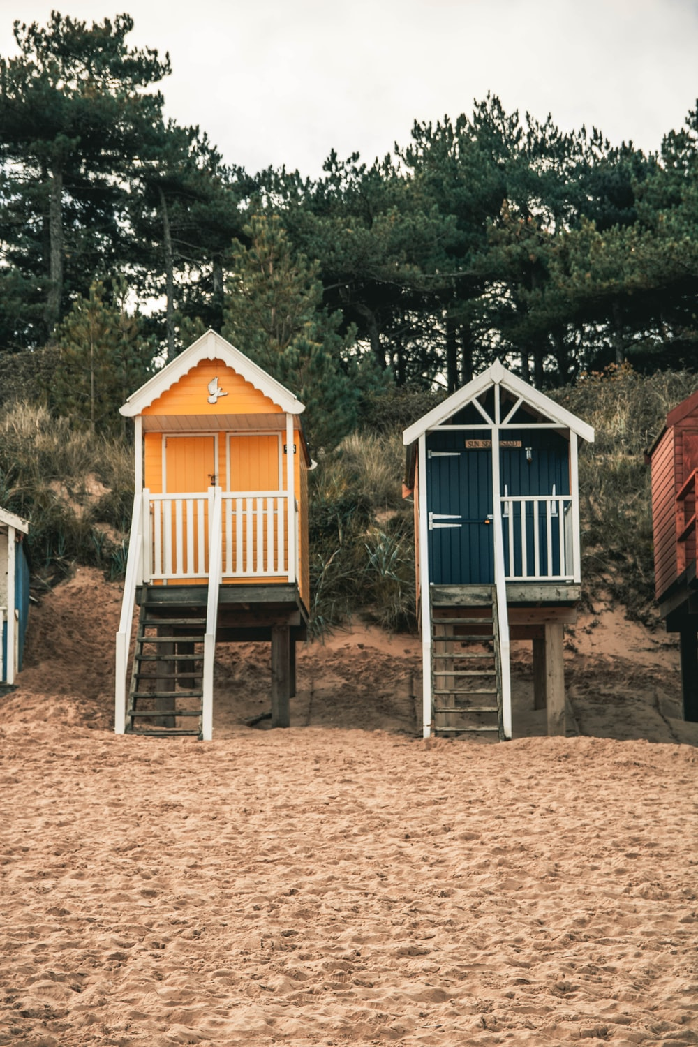 two yellow and blue closed house on beach