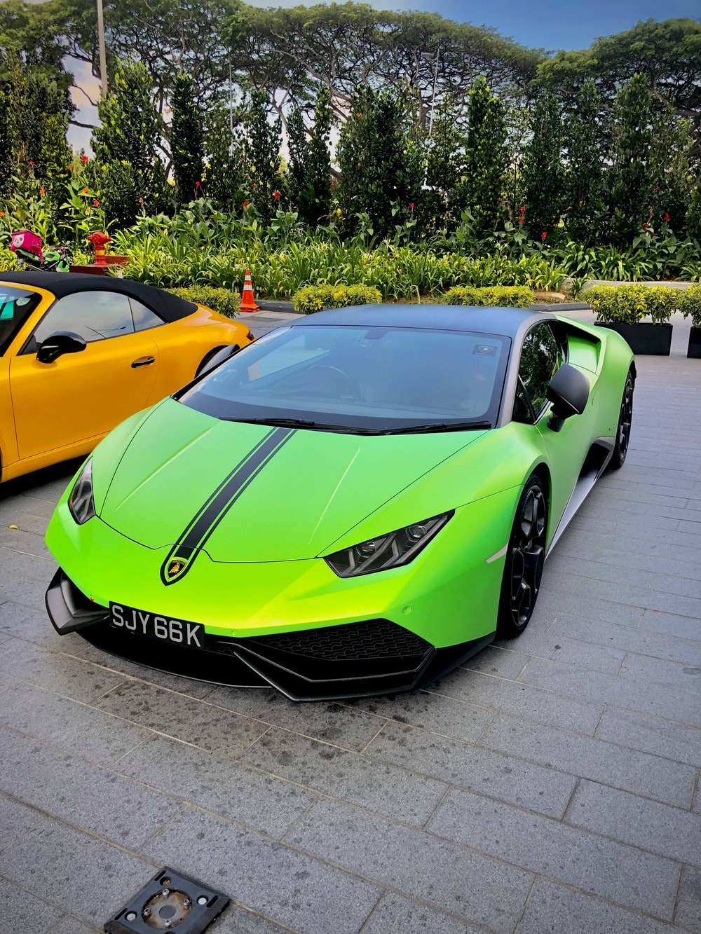 Green And Black Ferrari Parked Near Yellow Car Photo Free Automobile Image On Unsplash