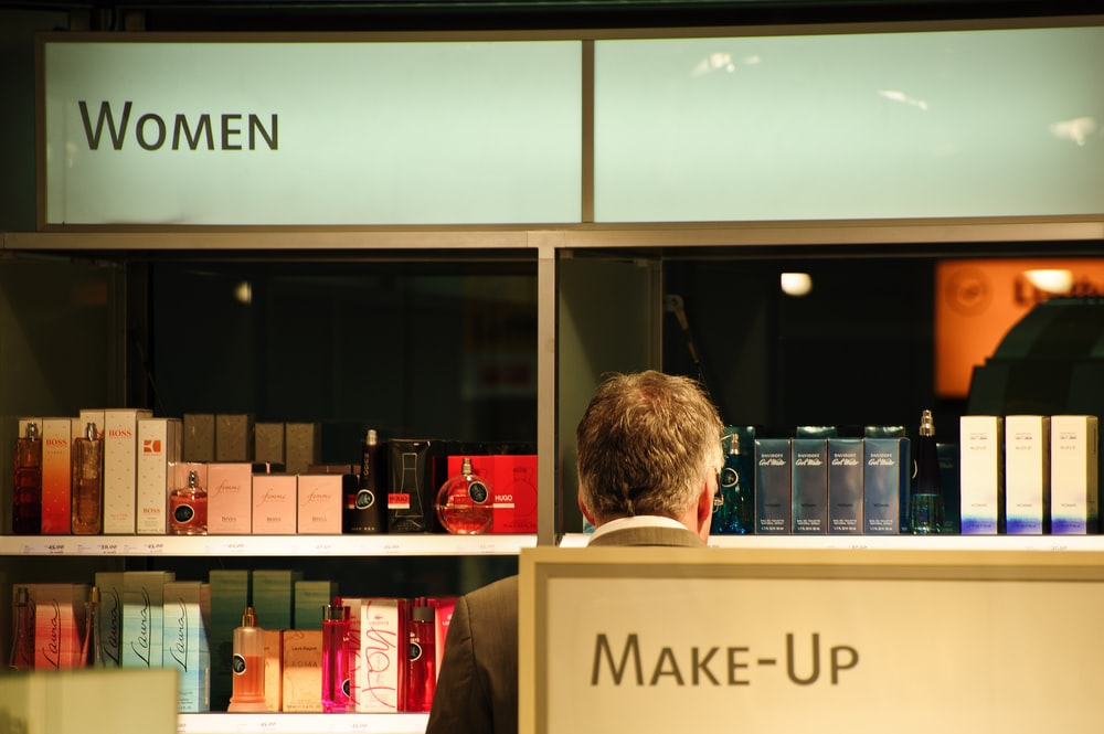 man front of store display