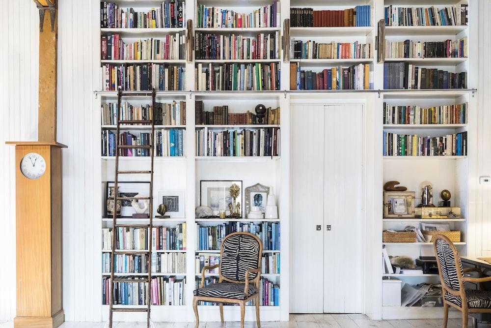 white wooden 4-layer shelf