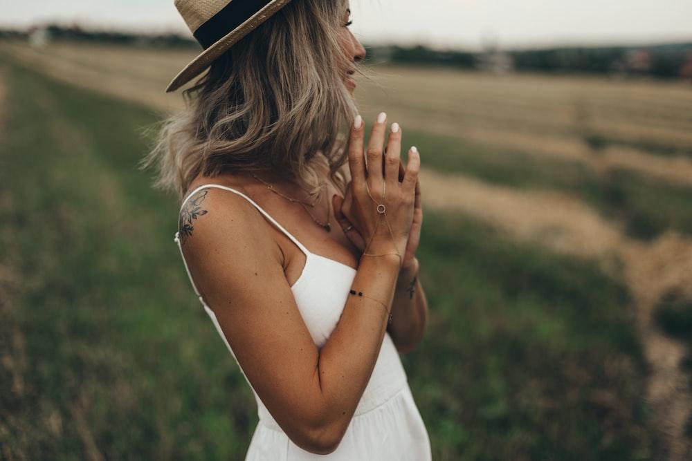 selective photo of woman in white spaghetti-strap dress