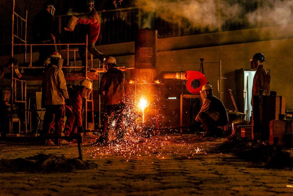construction men front of fire