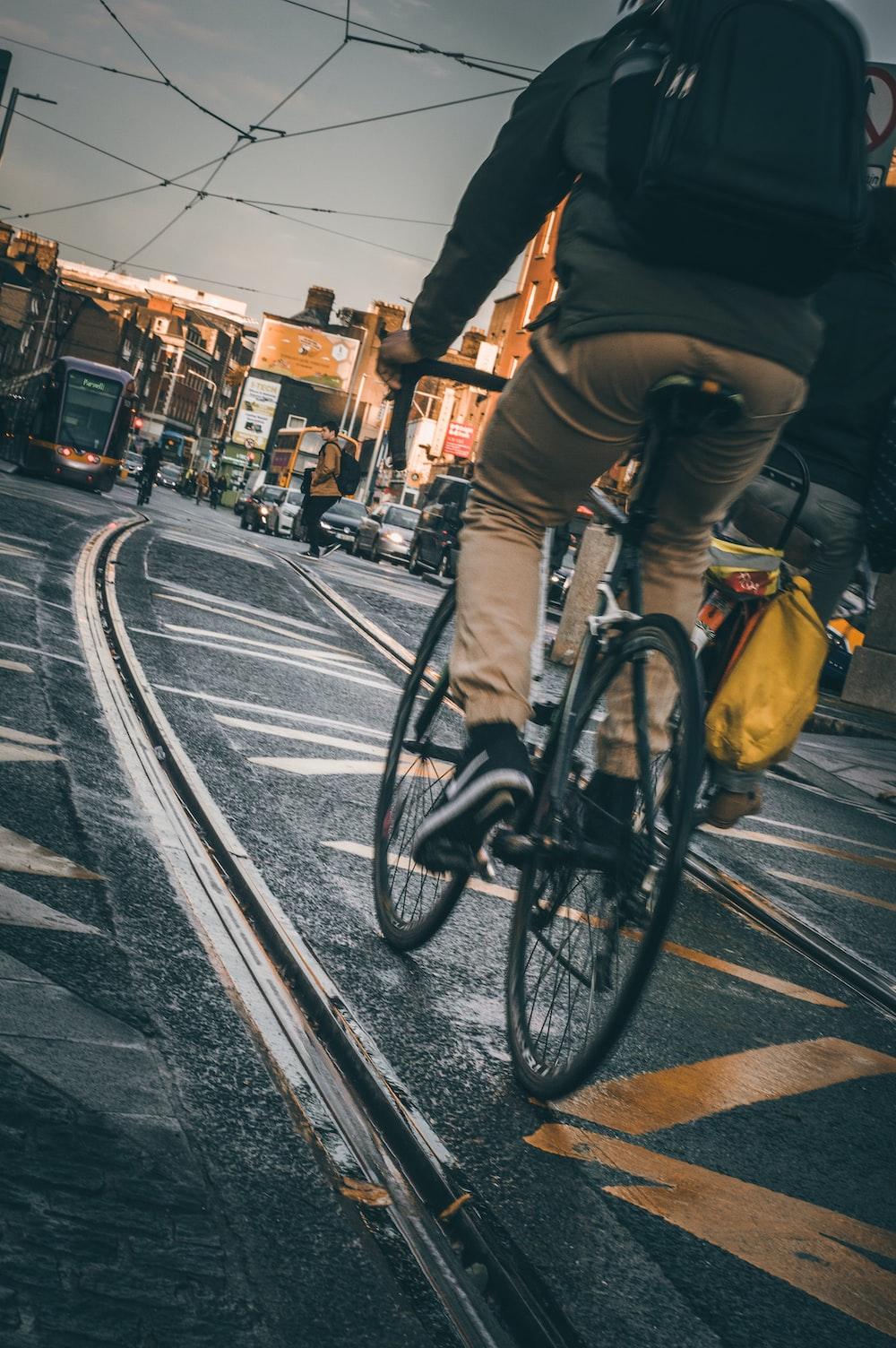 man on bike on road