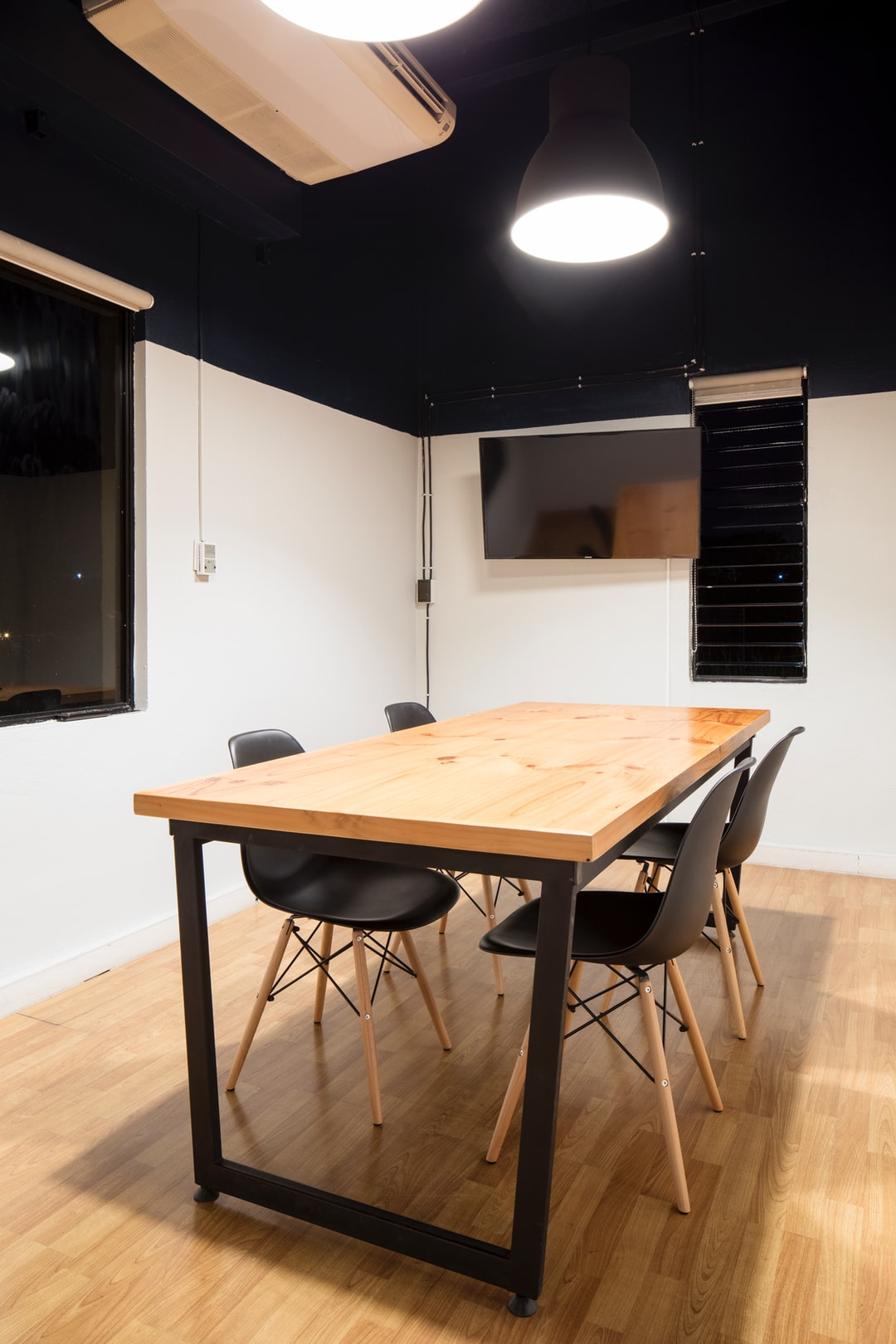Wooden table in a meeting room and TV