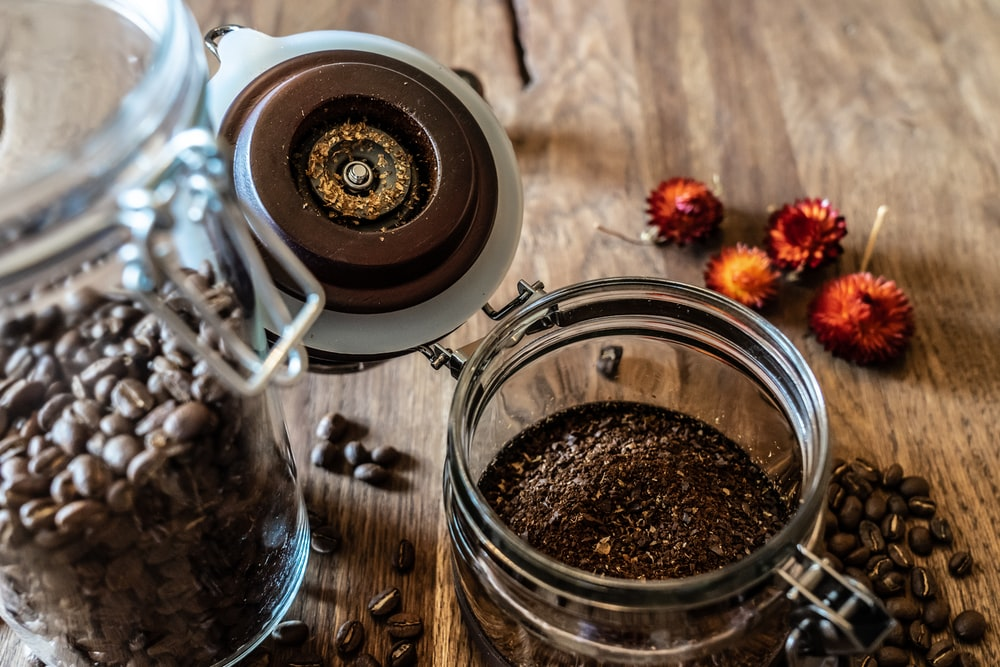 clear glass jar filled with coffee bens
