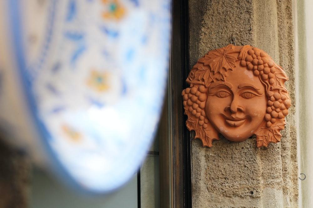 woman's face wall decor