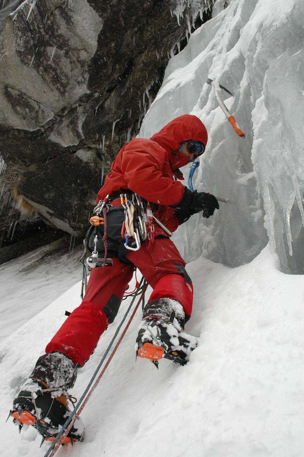 man wearing red jacket and pants