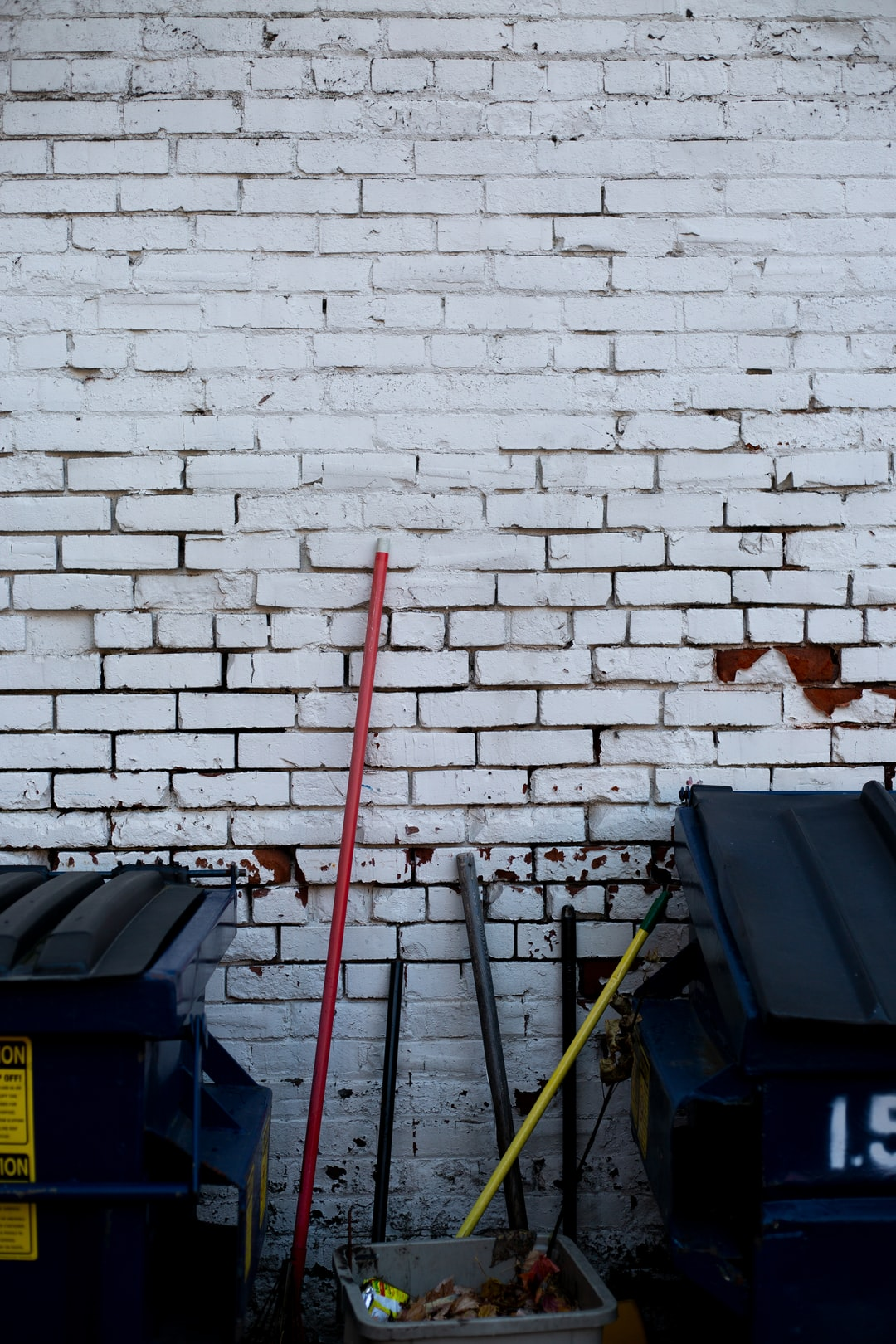 cleaning supplies against a wall