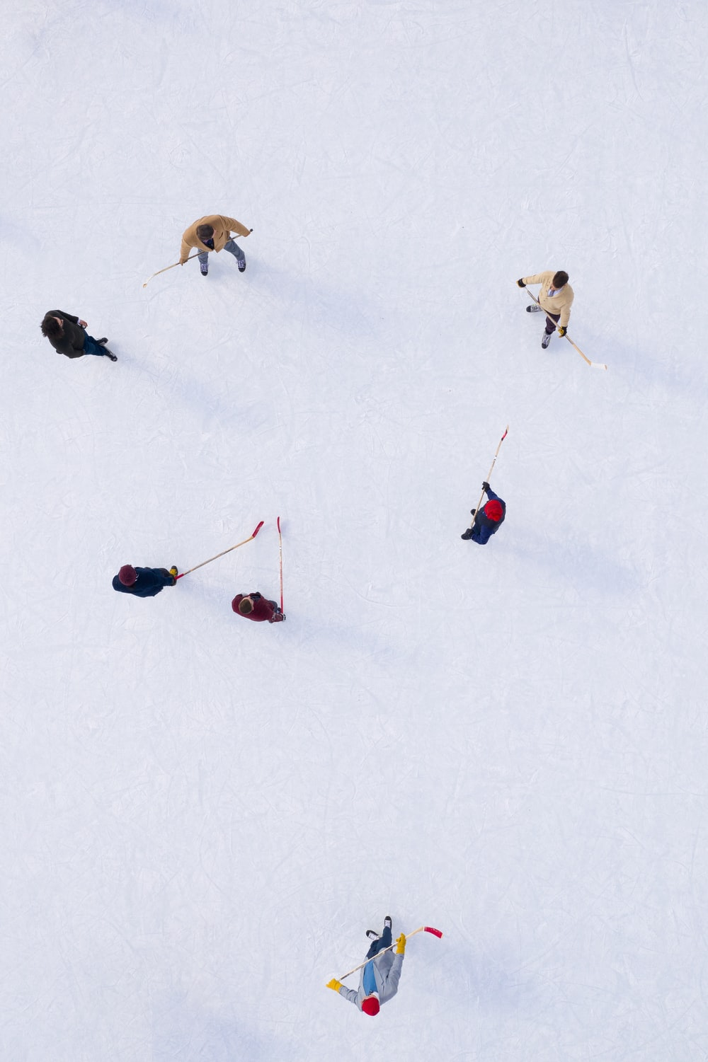 aerial view of people skiing on ice