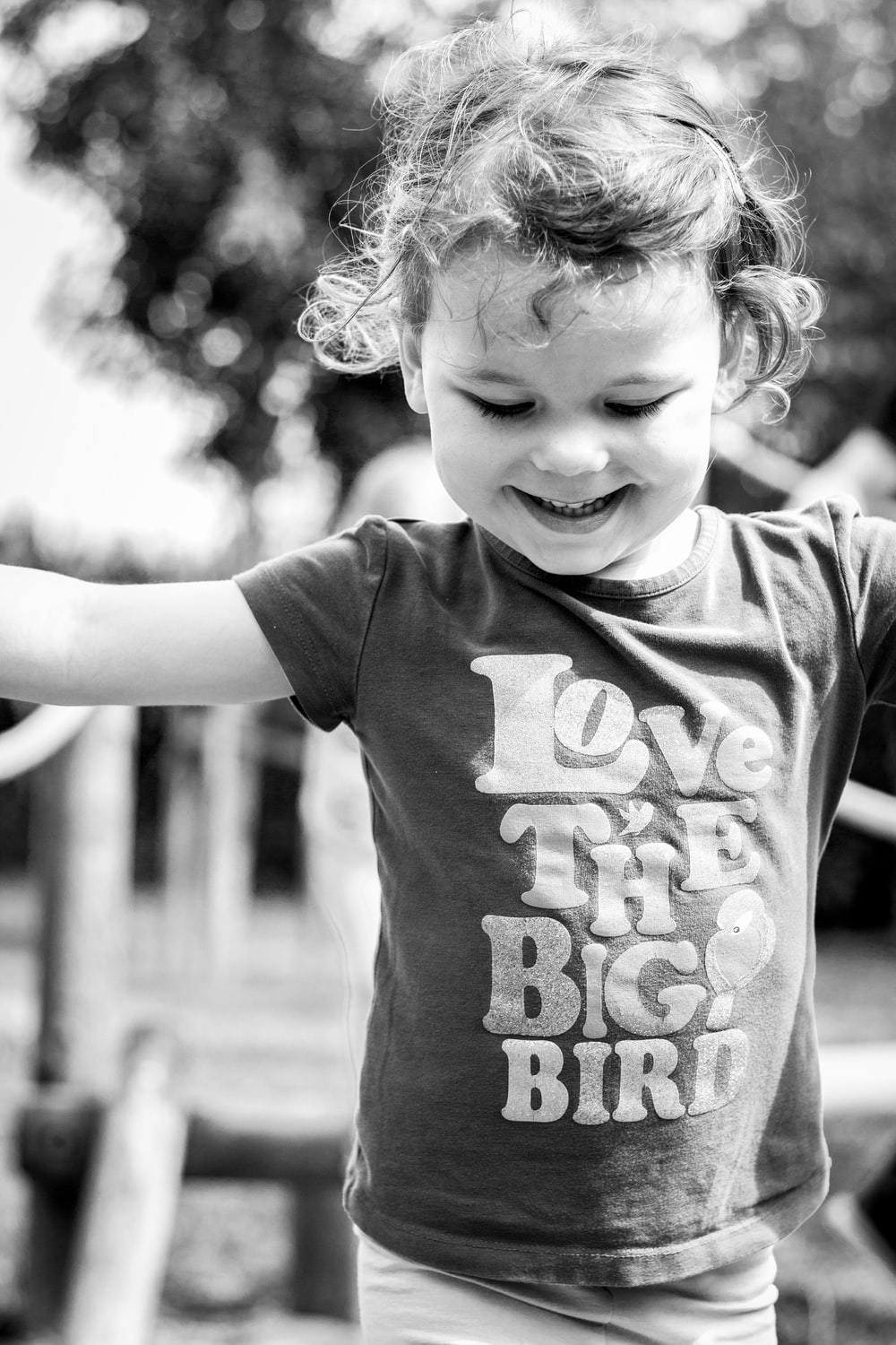 grayscale photo of girl in t-shirt