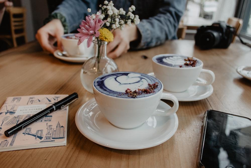 two white ceramic cups