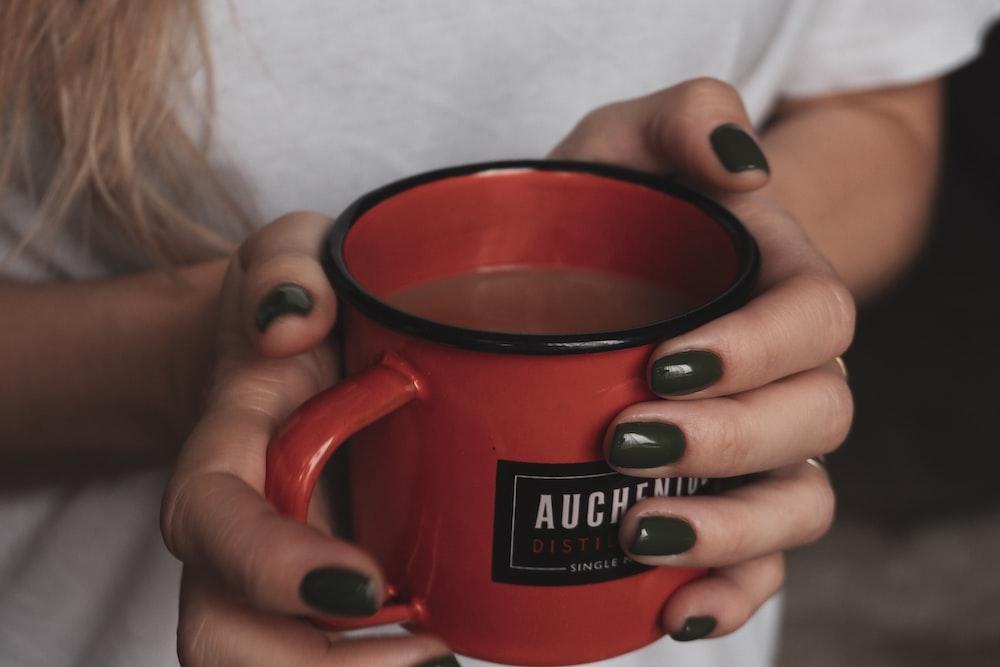 shallow focus photo of red ceramic mug