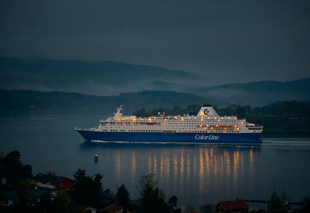 white and blue cruise ship