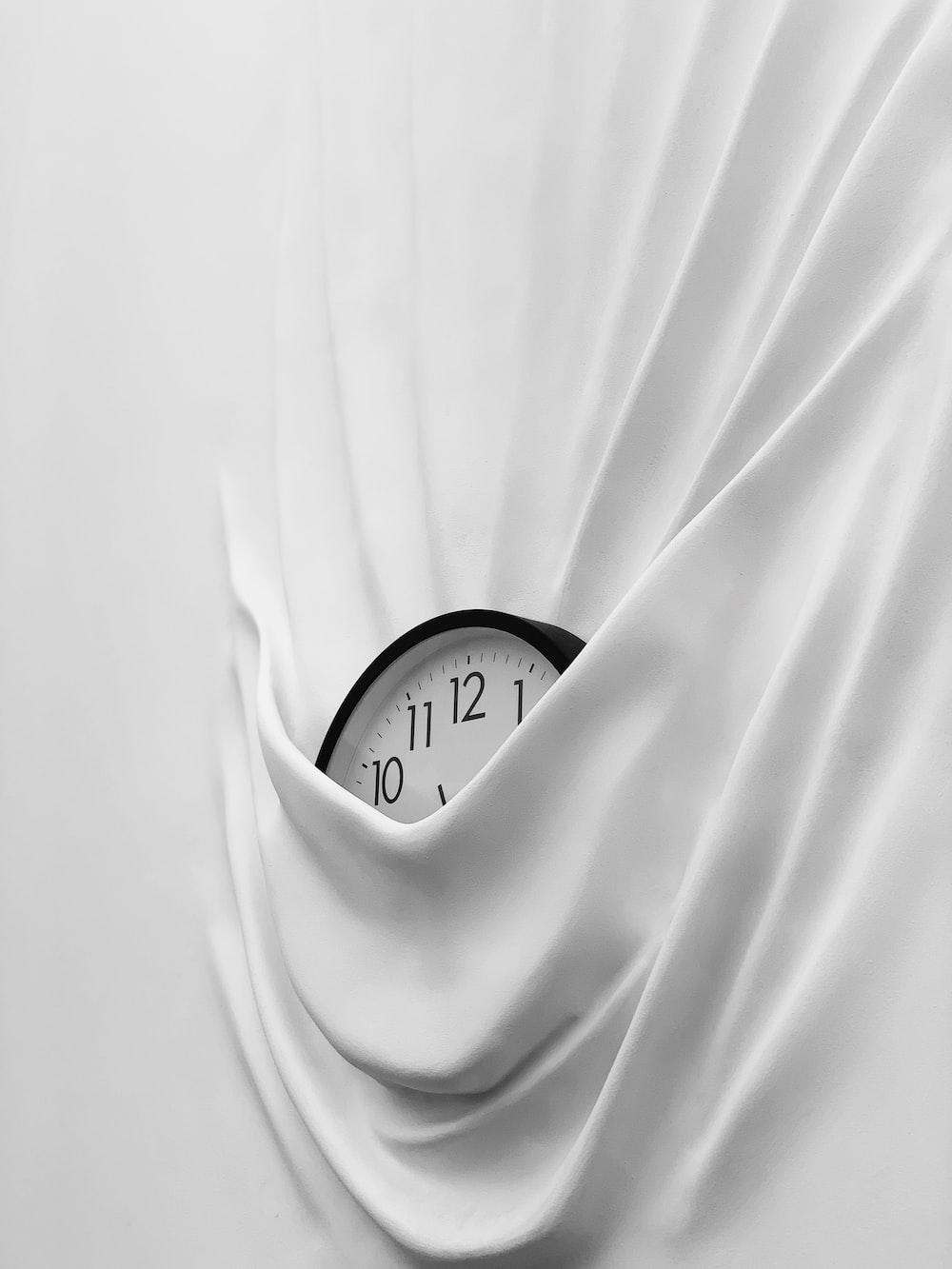 round white and black analog clock