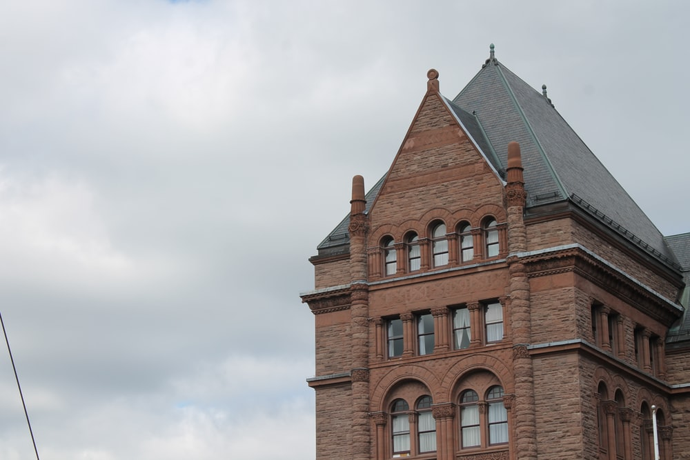 brown brick house under gray sky