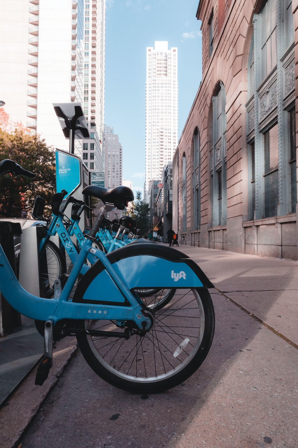 blue bikes parking near buildings during daytime