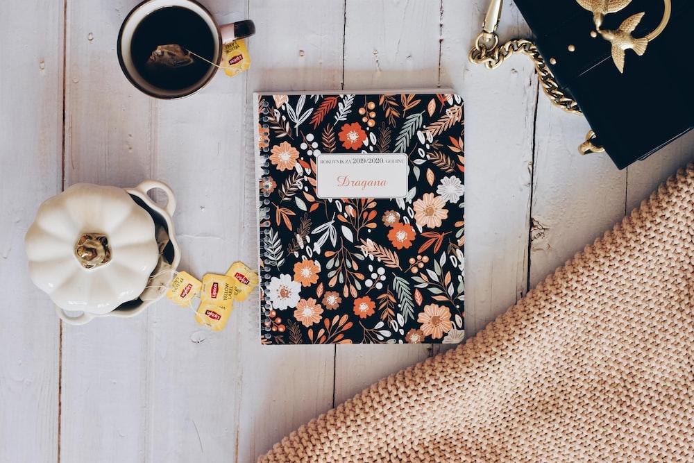 container beside notebookj