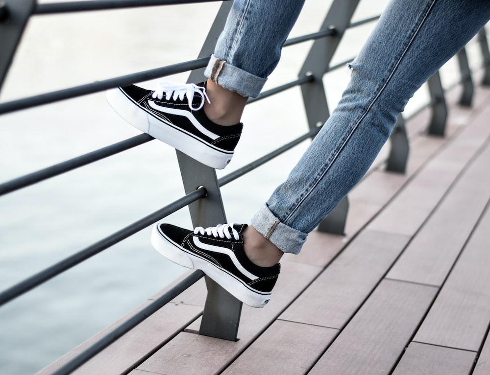 person wearing black Vans low-top sneakers