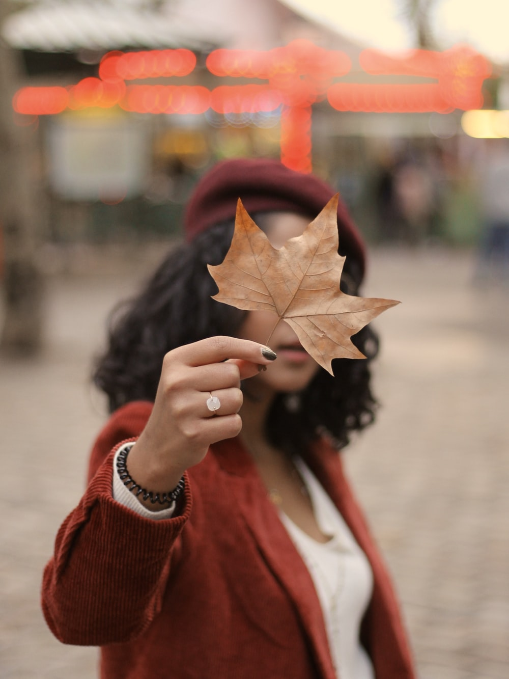woman standing and holding leaf