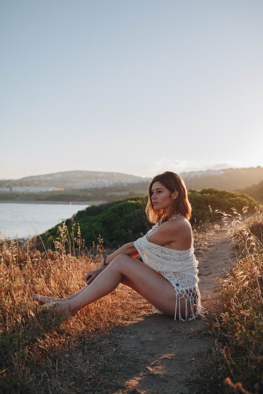 woman sitting near river