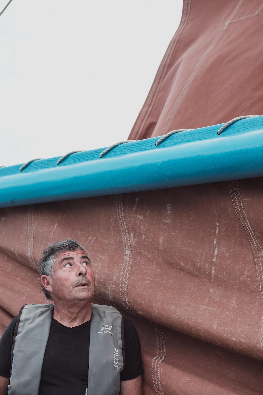 man under a blue roof