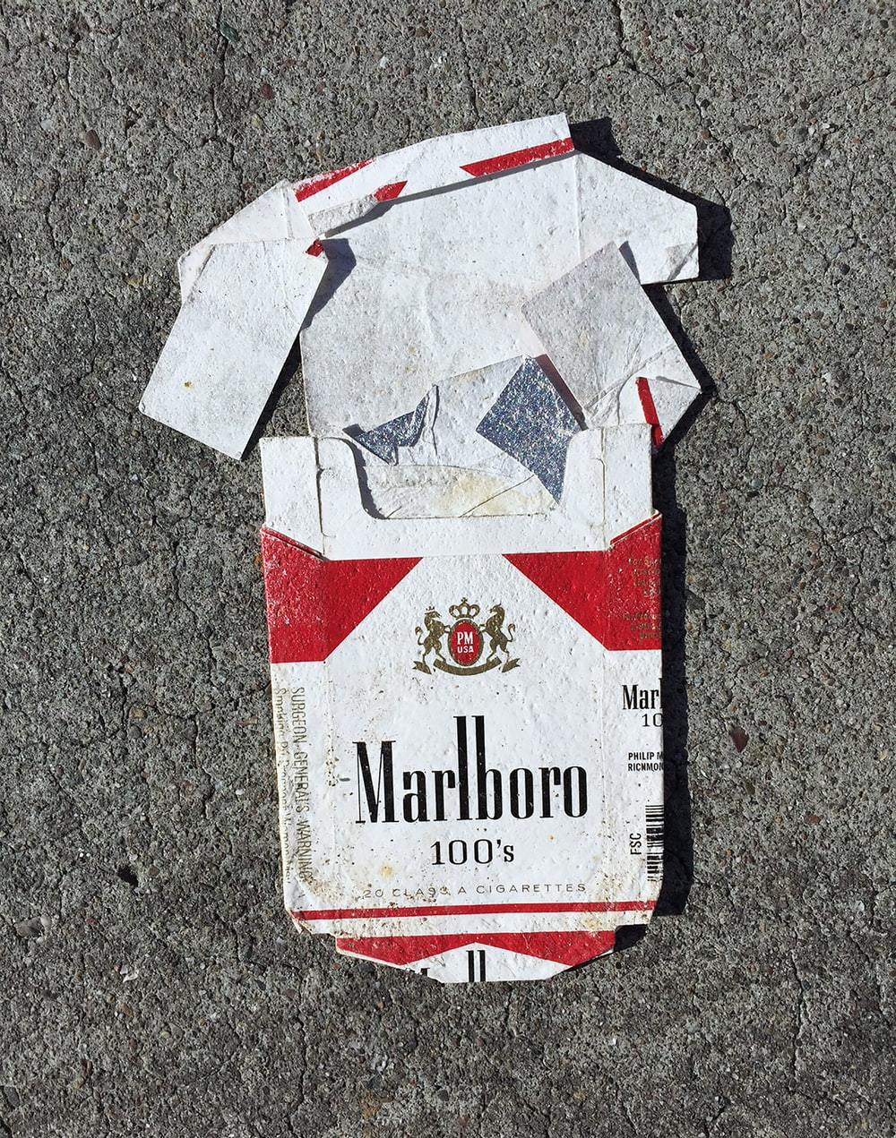 red Marlboro cigarette box on gray surface