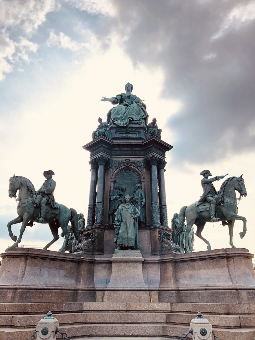 shallow focus photo of man riding horse statue