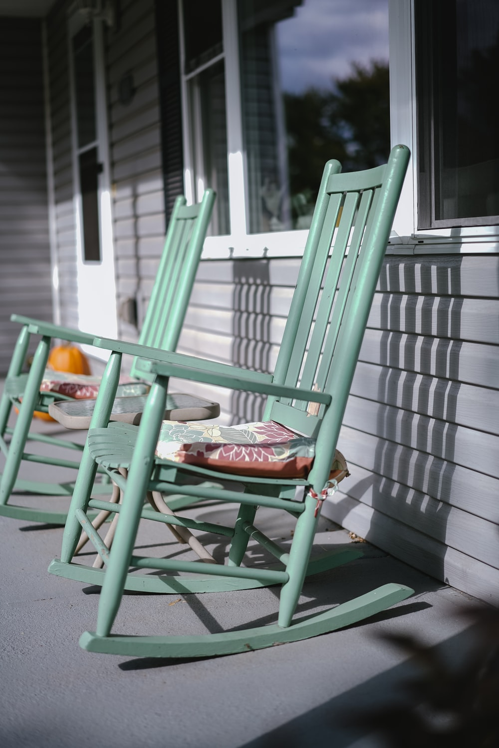 empty gray wooden rocking chairs