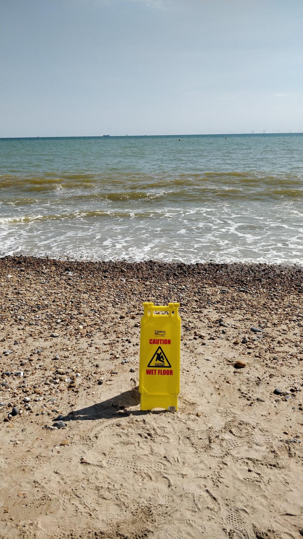 yellow early warning device on the seashore